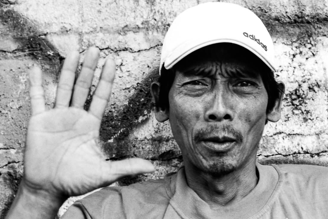 Man showing palm