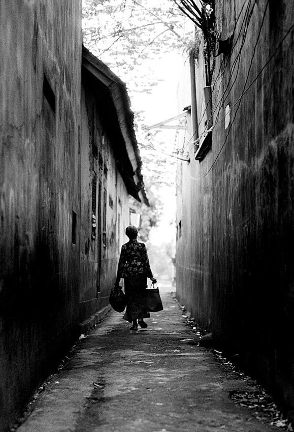 Older woman walking into back