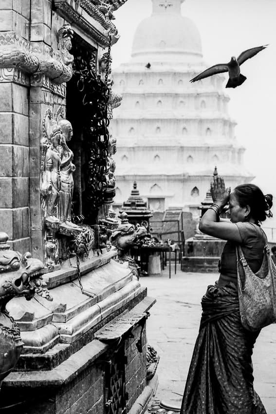 Woman praying in front of altar
