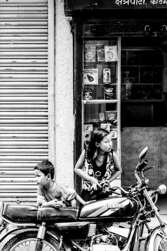 Siblings around motorbike
