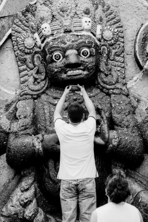 Man offering to Kala Bhairab
