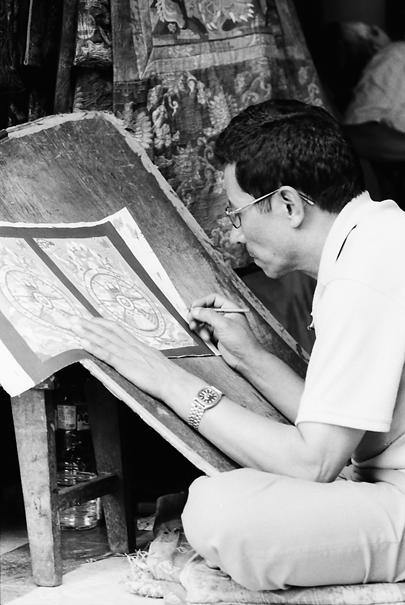 Man making mandala