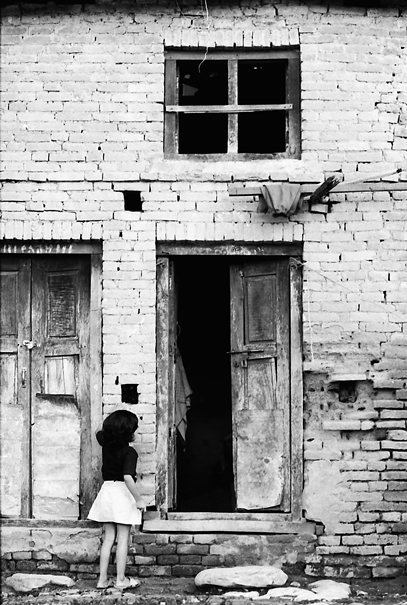 Girl In Front Of The Door @ Nepal