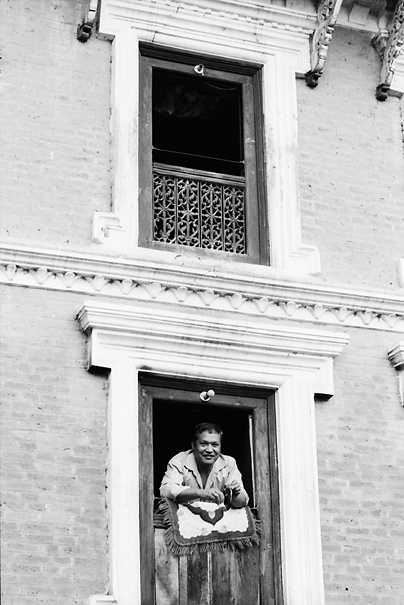 Man leaning out of window