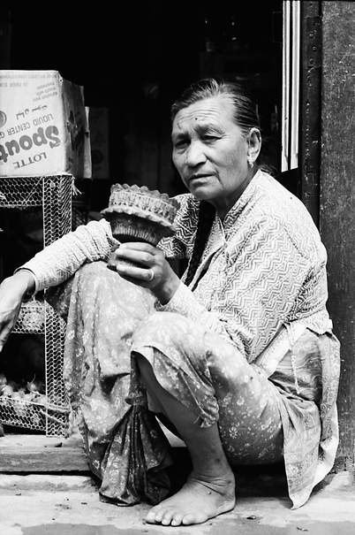 Older woman having part of water pipe