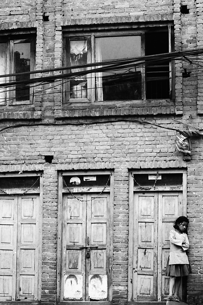 Girl Leaning Against The Wall @ Nepal