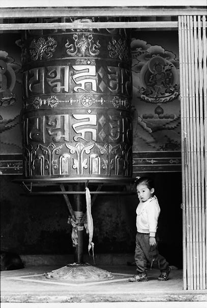 Little Girl Turing Around A Big Prayer Wheel @ Nepal