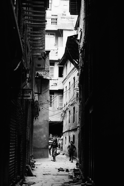 Figures In The Dark Alleyway (Nepal)