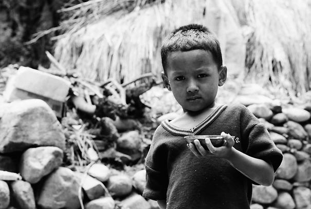 Boy holding vessel