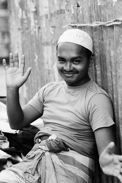 Smiling Man Wearing A White Cap (Bangladesh)