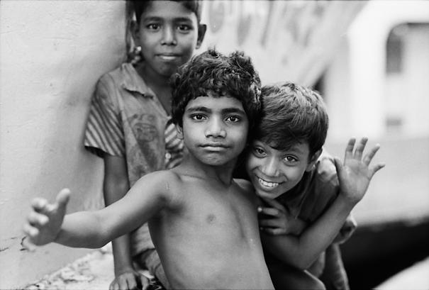 Three boys playing in Sadarghat