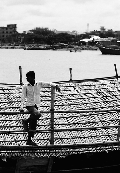 Man Standig On The Roof Of A Boat (Bangladesh)