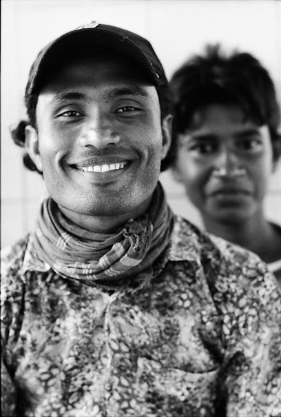 Skittshness Behind Grinning Man (Bangladesh)