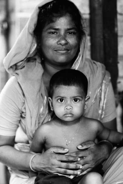 Mother With A Soft Face Holds Her Son (Bangladesh)