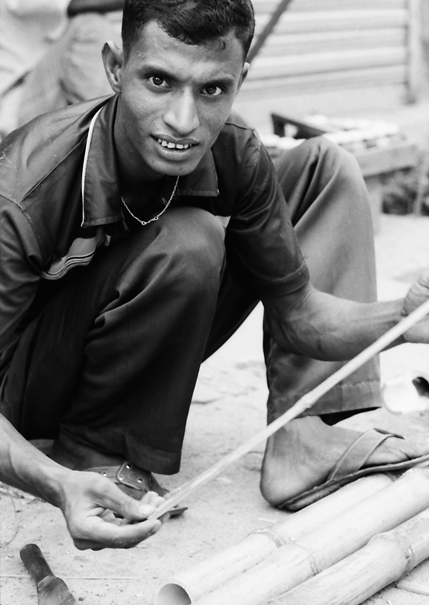 Man Holding A Measuring Rod @ Bangladesh