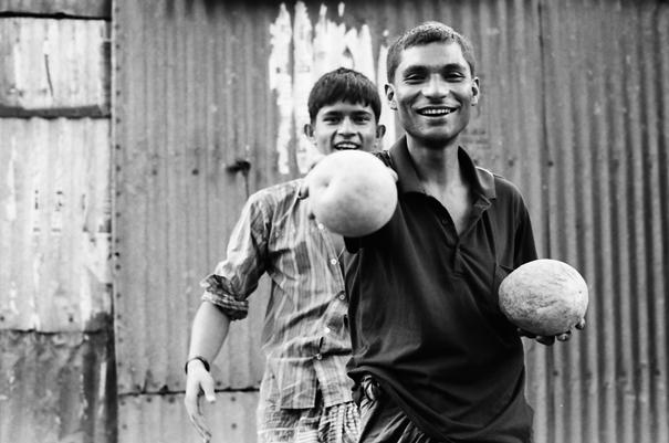 Man poking forward coconut