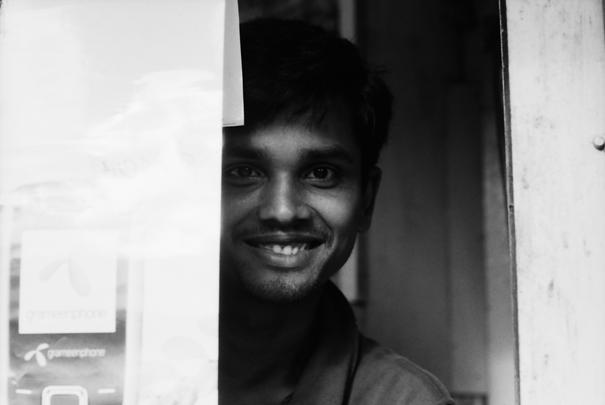 Man Shows His Teeth In His Shop (Bangladesh)