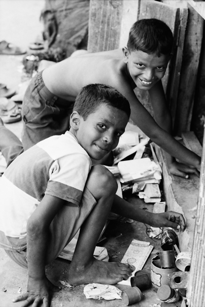 Two Boys  In A Heap Of Garbage (Bangladesh)