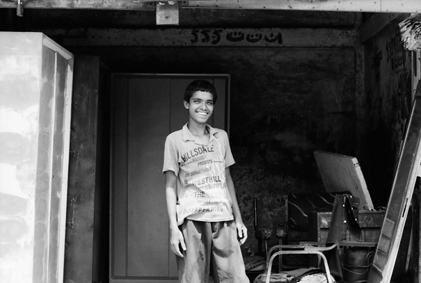 Boy Was Smiling In The Garage (Bangladesh)