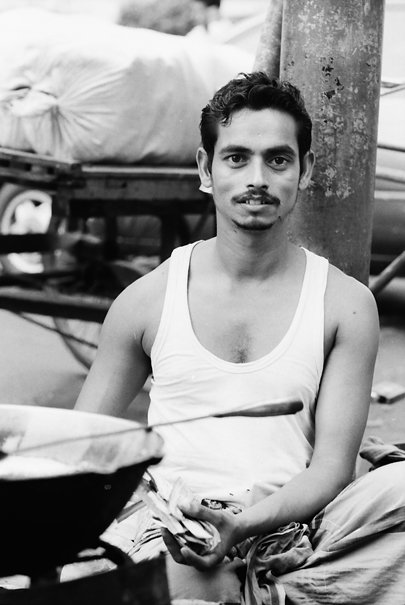 Man Sitting By A Pot (Bangladesh)