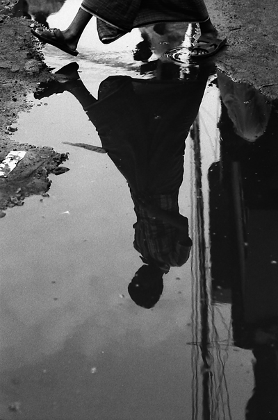 Shadow In The Puddle (Bangladesh)