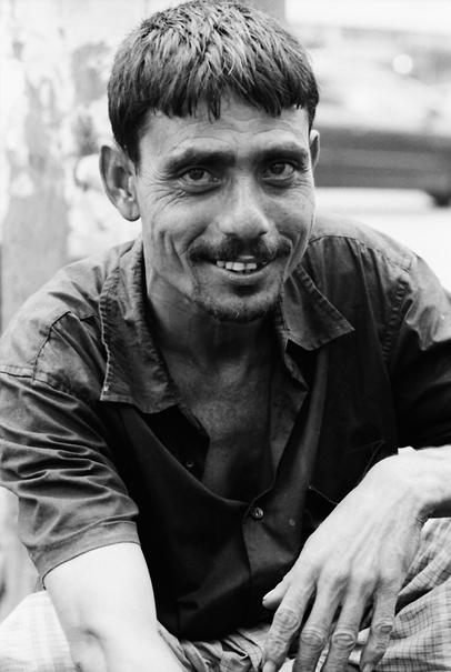 Rickshaw wallah smiling calmly