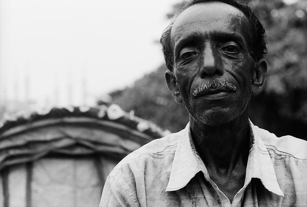 Tired rickshaw driver