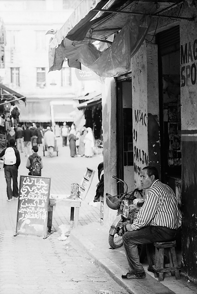 Man Sitting In Front Of A Shop (Morocco)