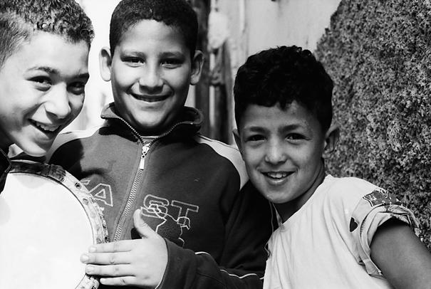 Three boys playing in lane