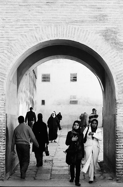 People walking through gate