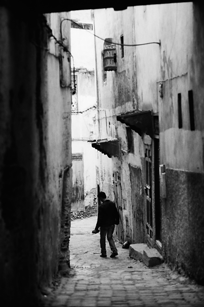Man Walking The Dim Lane (Morocco)