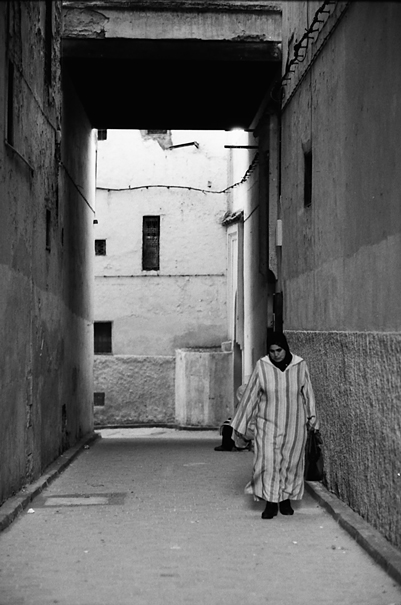 Woman Wearing Jellaba In The Lane (Morocco)