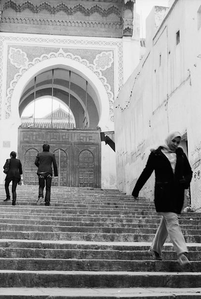 Woman descending stairway