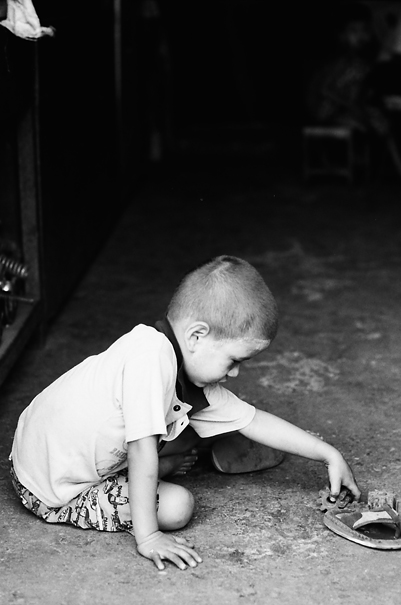 Boy playing with gear