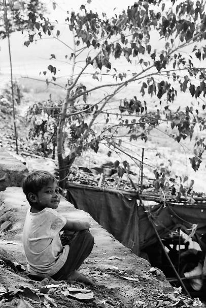 Boy sitting in shade