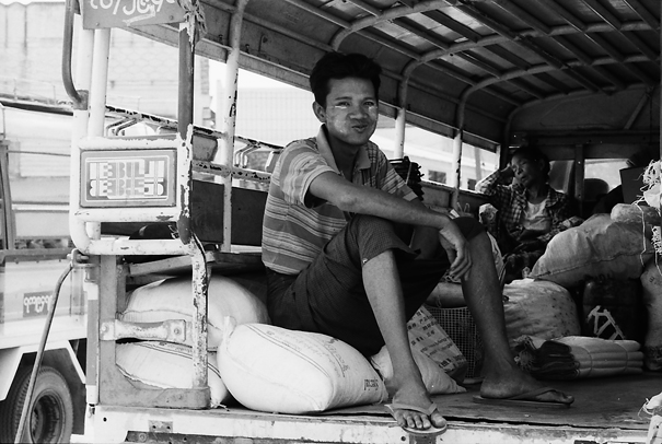 Man And Bags On The Truck (Myanmar)