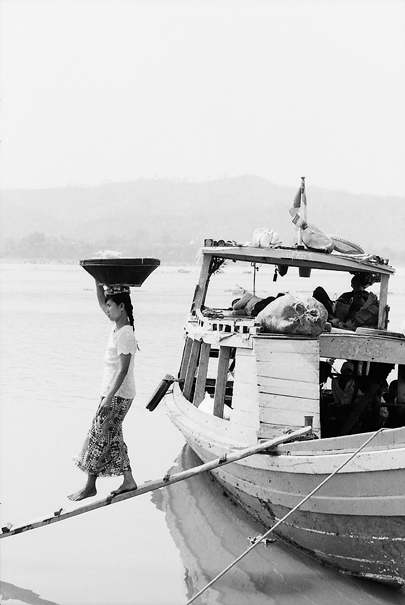 Disembarkation With A Big Basket On Her Head (Myanmar)