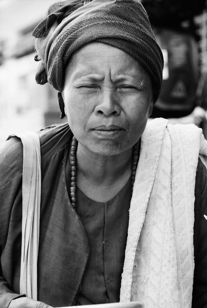 Squinching Woman Asked For Alms (Myanmar)