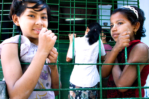 Two Girls At Wire Netting (Myanmar)
