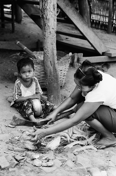 Mother cutting coconuts