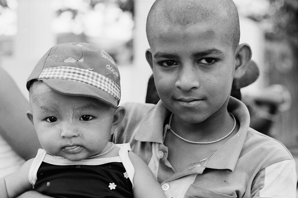 Baby In A Hat And Prick-eared Brother (Myanmar)