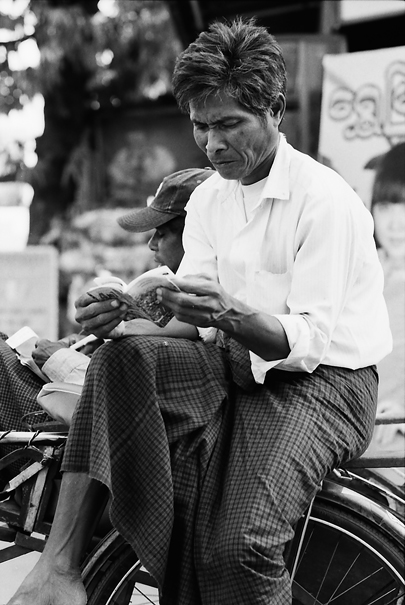 Man reading book on Saiq-ka