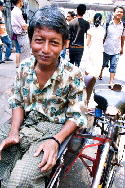Pedicab Driver Wearing A Longyi (Myanmar)