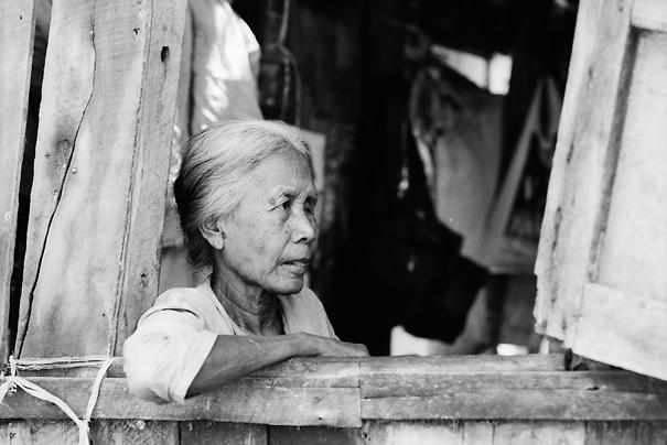 Older woman relaxing by window