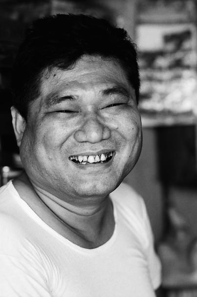Storekeeper smiling