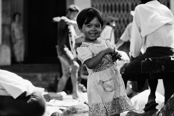 Girl playing in market