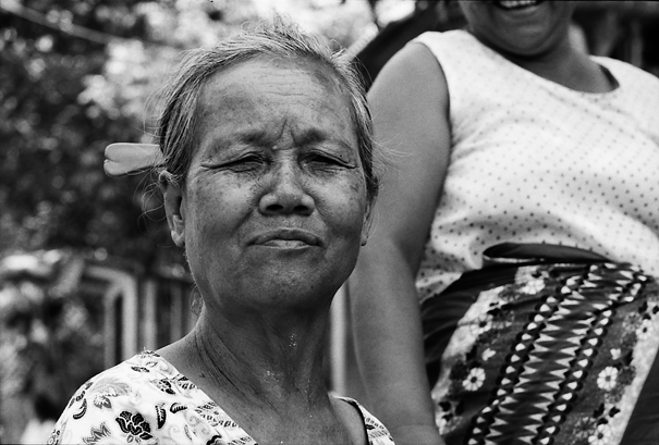 Older woman narrowing eyes