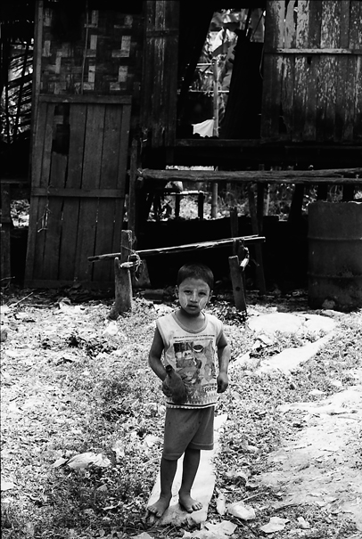 Boy standing in front of house