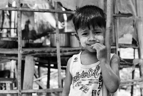 Boy Leaning Against A Bamboo Pillar (Myanmar)