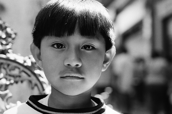 Boy with long-slitted eyes